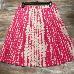 Bright pink and beige pleated skirt w/ buttons 
